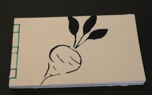 beet.  The dark blue beet is a stencil cut from thin paper and silkscreened onto the front and back of this book.