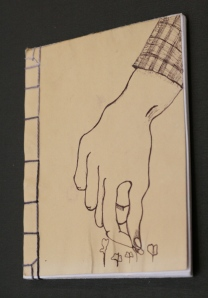 Thinning brassicas.  This image came out of a lot of sketching I've been doing for my printmaking class.  I've been thinking about hands, work, and the many tasks hands perform.  Modified simple Japanese stab binding.  Winter 2009.